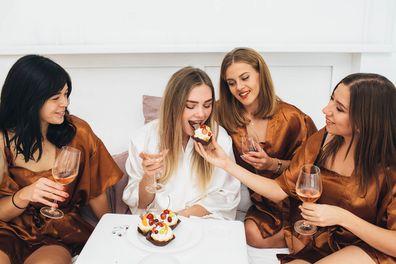 Bride and bridesmaids eating