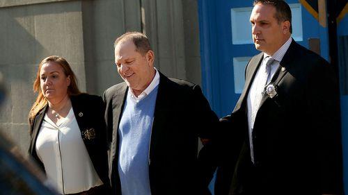 Weinstein leaves the New York police precinct in handcuffs. (AAP)