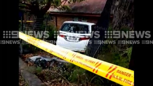Police have arrested one person and are searching for another after a car crashed through the fence of a Sydney school.