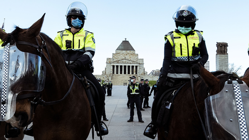 Police officers stand watch as anti lockdown protesters gather at the Shrine of Remembrance on September 05, 2020 in Melbourne, Australia.