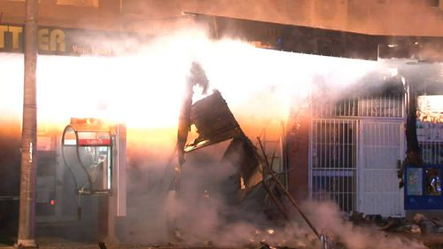 The explosion ripped through the front of the store. (9NEWS)