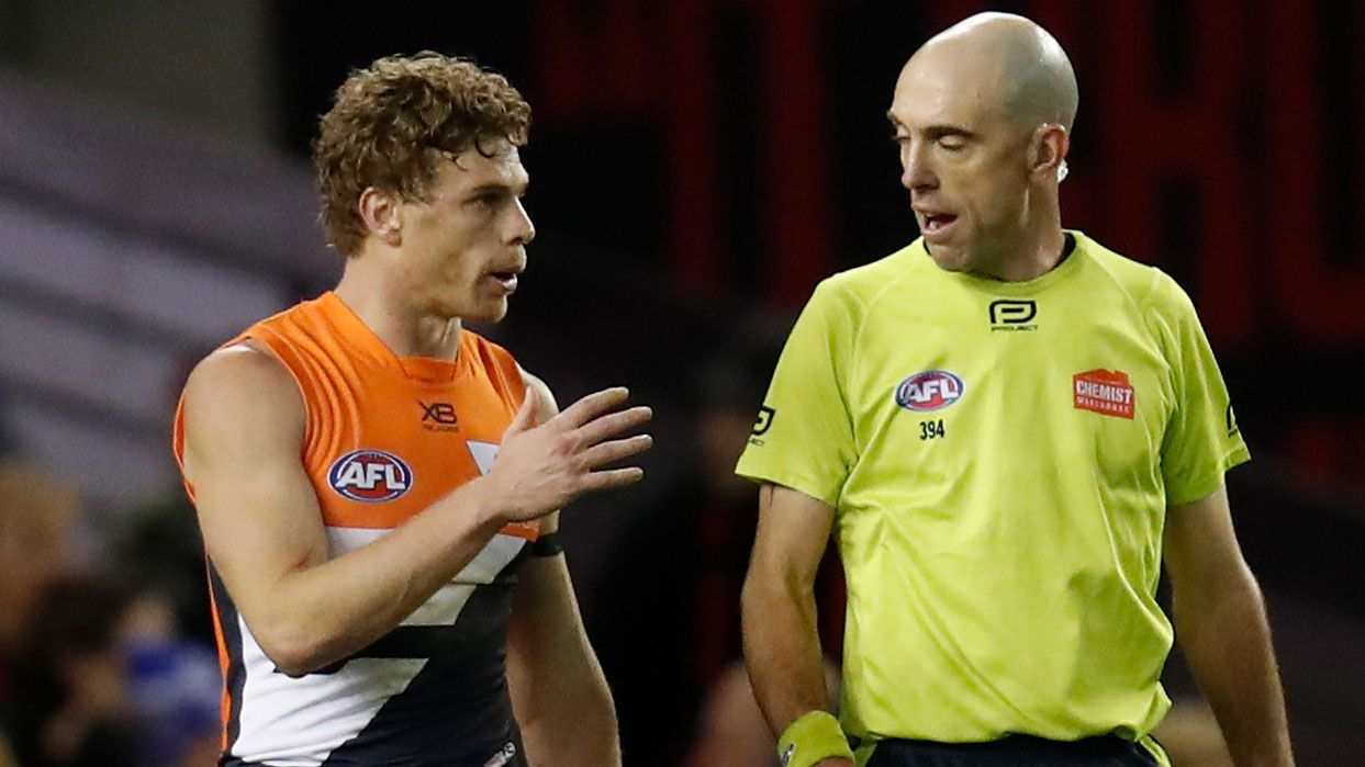 Giants player Adam Kennedy talks to umpire Matthew Nicholls.