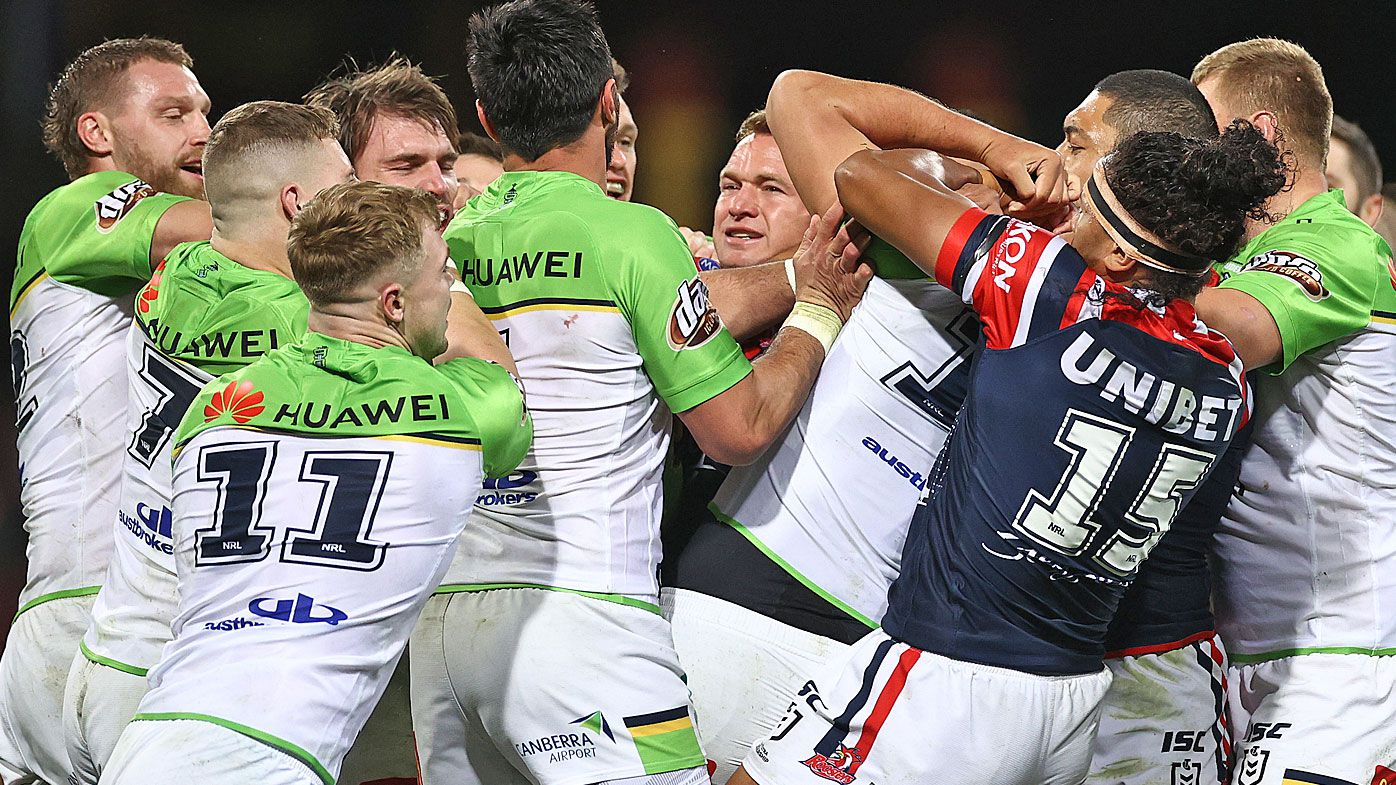 Players scuffle during the round 10 NRL match between the Sydney Roosters and the Canberra Raiders