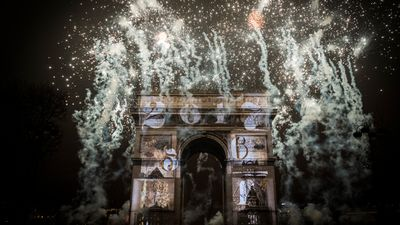 <p>The Arc De Triomphe was shrouded in a dazzling pyrotechnics display in Paris, France.</p> <p> (AFP) </p>