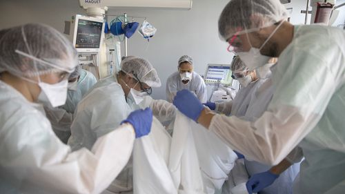 Medical workers tend to a patient suffering from COVID-19 in the Nouvel Hospital Civil of Strasbourg, eastern France (Photo: September 2020)