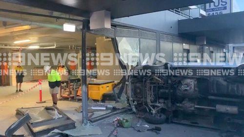 Car crashes into Gold Coast shop, man on the run