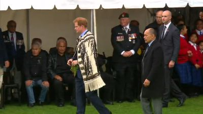 As part of his tour of New Zealand Prince Harry donned the traditional korowai cloak during a visit to Whanganui. (9NEWS)