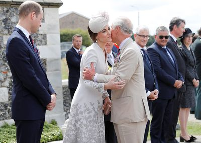 Charles greets Kate Middleton at the ceremony.