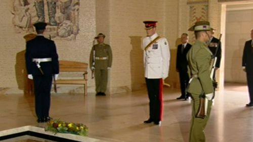 Harry observed a moment's silence after laying the wreath. (9NEWS)