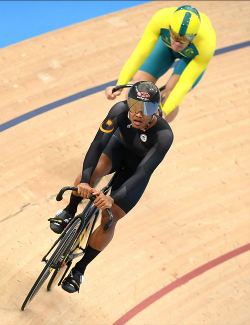 Sahrom of Malaysia in front of Glaetzer during the men's sprint qualifying event. (AAP)