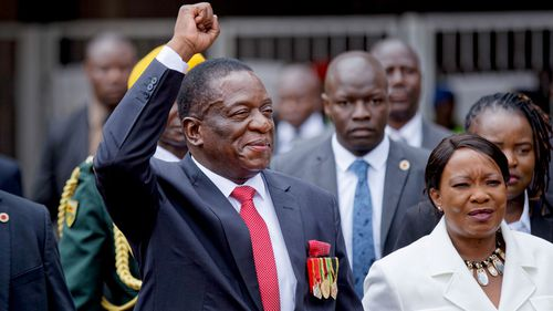Emmerson Mnangagwa and his wife Auxillia, right, arrive at the presidential inauguration ceremony in the capital Harare, Zimbabwe. (AAP)
