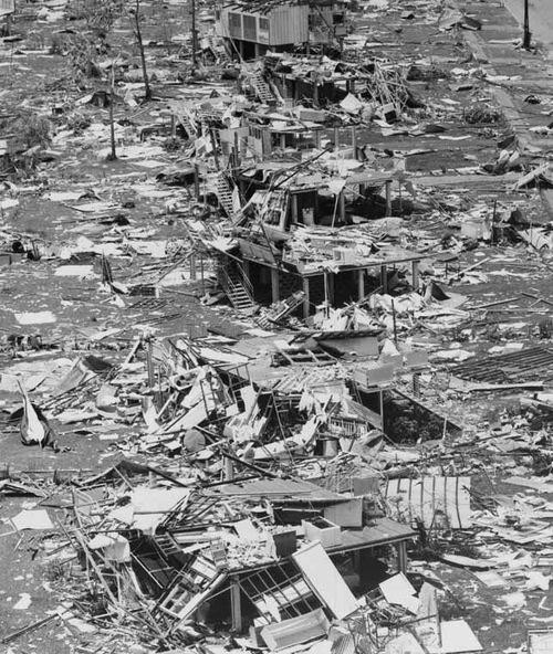 A photograph on June 26, 1975 of Darwin after Cyclone Tracy hit last Christmas day shows a row of stilt houses smashed and surrounded by rubble.