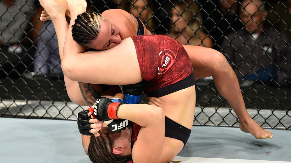 Sarah Moras dislocates Ashlee Evans-Smith's elbow with brutal armbar at UFC 215