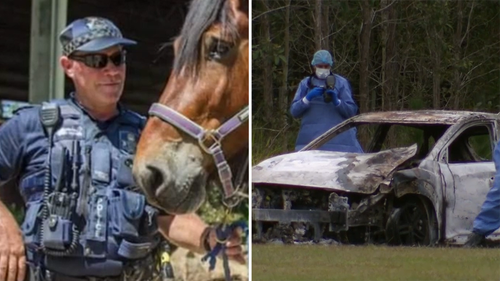 Queensland Police officer David Masters killed by car while laying road spikes to stop allegedly stolen car.