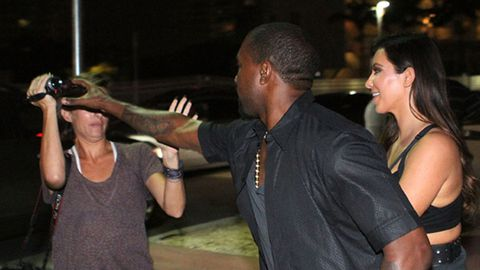 When Kanye attacks: Rapper lets loose at pap to protect Kim - who's wearing a see-through dress