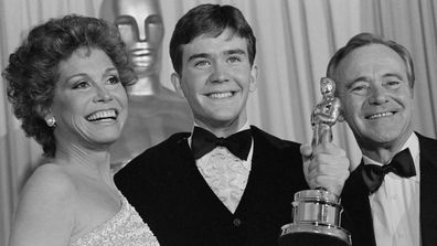 Timothy Hutton holds up his Oscar with presenters Mary Tyler Moore and Jack Lemmon (right), after he was awarded the Best Performance by an Actor in a Supporting Role at the 53rd Annual Academy Awards here March 31.