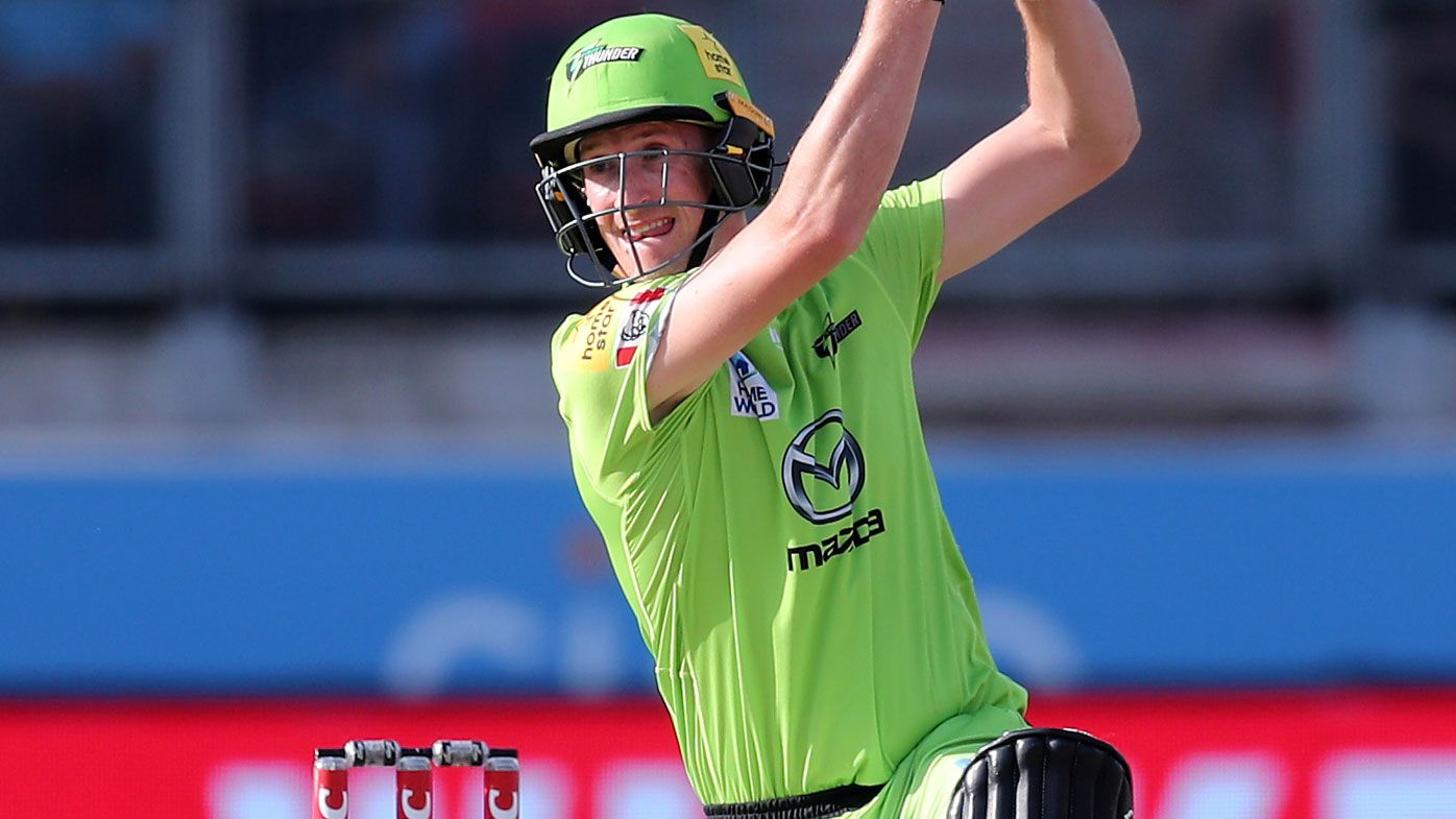Sydney Thunder's Chris Morris hits the winning runs during the Big Bash League