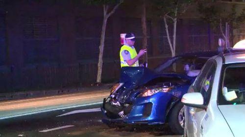 Woman in hospital under police guard after Sydney crash