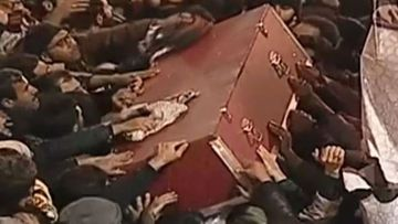 Mourners jostled with each other to touch or rub cloth on Qassem Soleimani's coffin as it surfed its way across the sea of people.