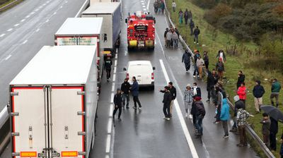French police have taken up almost permanent positions on the motorway as they try to keep the peace between truck drivers and those looking for a way into the UK. (Photo: AFP/Philippe Huguen)