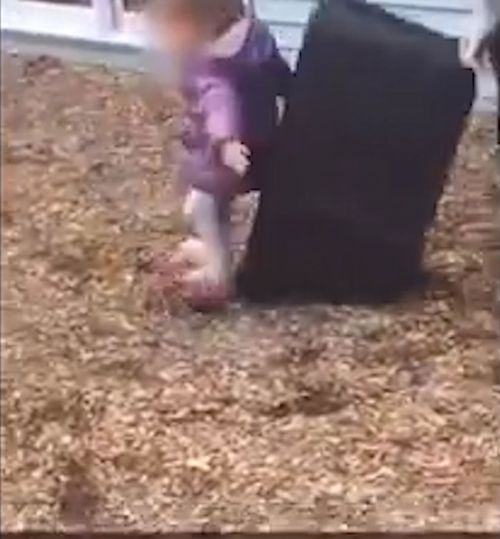 The crying child attempts to stand up before being pushed back down to the ground. (KCCI)