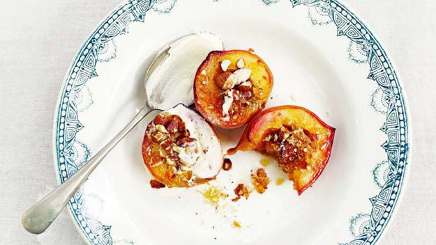 Honey-baked peaches with almond praline and mascarpone