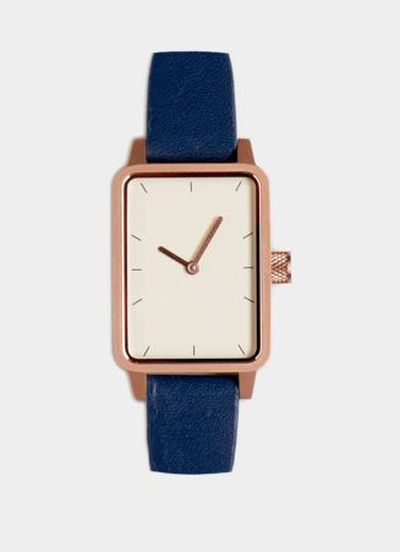 "<a href=""https://simplewatch.co/collections/womens-collection/products/3-watch-gold-navy-32mm"" target=""_blank"">Simple No 3 Watch in Gold and Navy, $249.</a>"