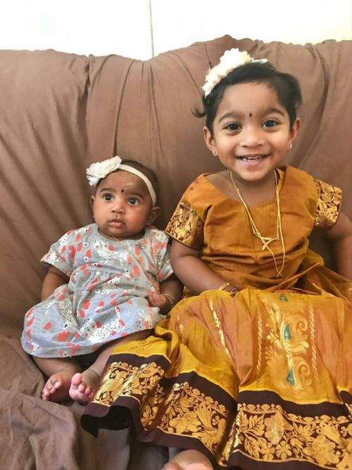 Kopiga, 2 (right) and Dharuniga, nine months, were born in Australia. (Image: Facebook/Tamil Refugee Council)