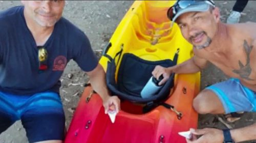 Two men returned to shore unscathed after a great white shark attacked their kayak leaving two giant teeth behind.