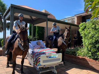 Mrs Meredith with members of the mounted unit of the NSW police.