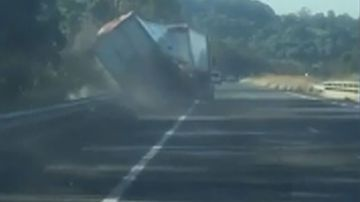 The footage shows the truck veering all over the road.