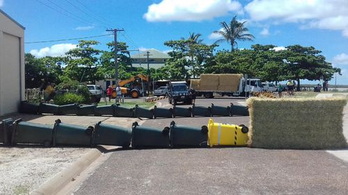 "Locals worked to create a ""wheelie bin blockade"". (Queensland Police)"