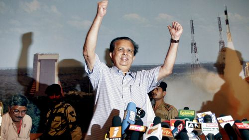 Indian Space Research Organization Chairman G. Madhavan Nair raises his hands to celebrate the successful launch of India's maiden lunar mission Chandrayaan-1.