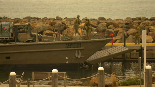 Military vehicles arrive in Mallacoota.