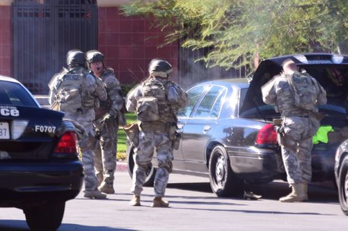 Heavily armed police at the scene. (Doug Saunders/AAP)
