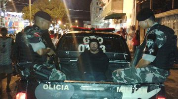 This late Tuesday, Feb. 13, 2018 photo released by the Military Police press office in Brazil's Para state, shows military police escorting who they identify as Jose Irandir Cardoso in the back of a police truck in Breves, Para state, Brazil. The man convicted in the killing of yachtsman Sir Peter Blake was caught after being on the run for more than 15 years. (Military Police press office in Brazil's Para state, via AP)