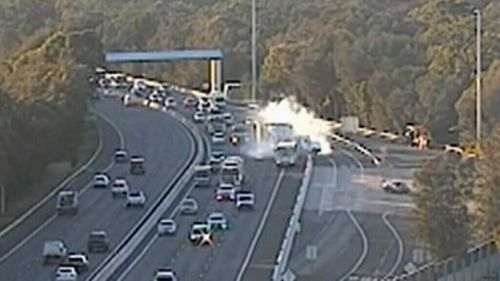 The accident caused a semi-trailer to jackknife on the busy M5 Motorway. (9NEWS)