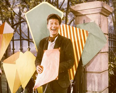 Dick Van Dyke, US actor, poses with a variety of kites in a publicity still for the film, 'Mary Poppins', USA, 1964. The film musical, directed by Robert Stevenson (1905–1986), starred Van Dyke as 'Bert'.