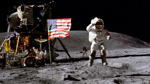 In this April 1972 photo made available by NASA, John Young salutes the U.S. flag at the Descartes landing site on the moon during the first Apollo 16 extravehicular activity. (NASA)