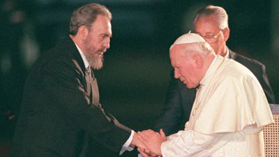 In this Jan. 25, 1998  photo, Cuba's leader Fidel Castro, left, greets former Pope John Paul II at the Jose Marti International Airport in Havana. (AAP)