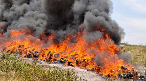 Townsfolk, press feel 'unusual' after Indonesian police burn half a tonne of cannabis