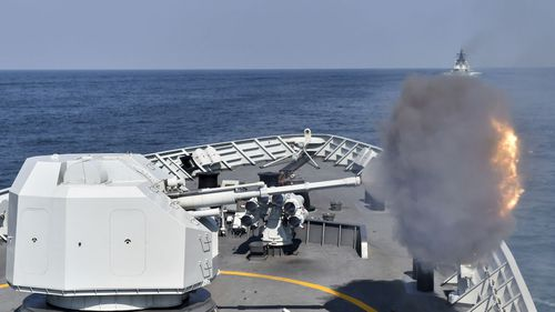A Chinese frigate opens fire during a live drill.