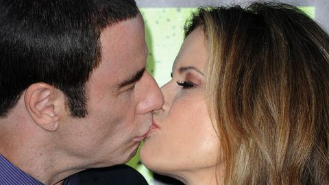 John Travolta and wife kiss for cameras after latest sexual assault claim