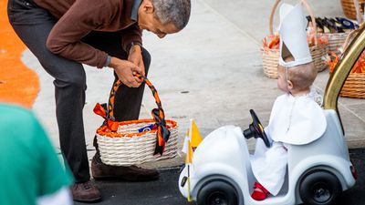 This youngster, dressed as recent visitor Pope Francis, won the president's vote as best dressed. (AAP)