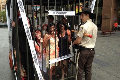 "Fortunately, the zombies were confined to a cage... until they escaped for a ""zombie walk"" during the lunchtime rush-hour. (Certainly gives ""food court"" a whole new meaning.)"