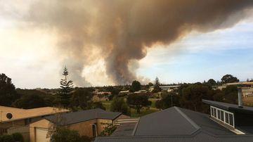 Smoke is seen rising in Esperance as bushfires continue to burn across the region.