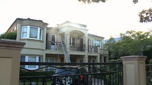 The girl jumped from the balcony (pictured) to escape the flames. (9NEWS)