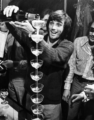 Football legend George Best was known for his champagne lifestyle. (Supplied)