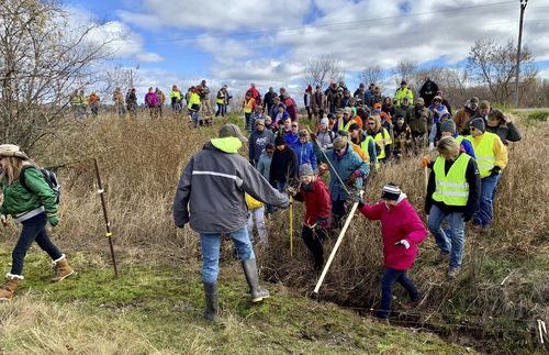 Volunteers search for 13-year-old Jayme Closs in October 2018 after her parents were found shot dead and she was missing.