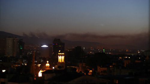 Smoke rises over Damascus following the airstrikes. (AAP)